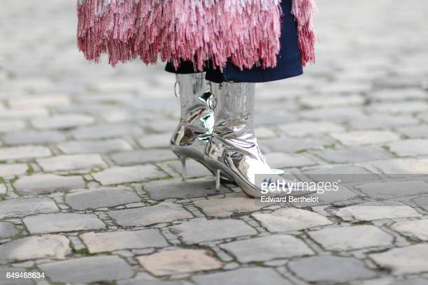 Silver boots are seen outside the Shiatzy Chen show during Paris Fashion Week Womenswear Fall/Winter 2017/2018 on March 7 2017 in Paris France