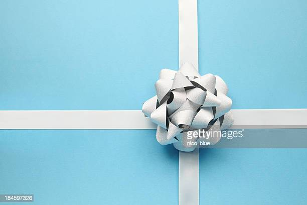 silver bow on blue - tied bow stock pictures, royalty-free photos & images