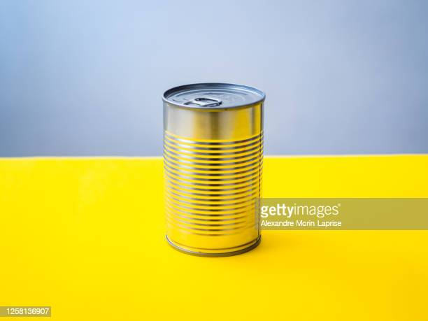 silver can on a yellow background - tin can stock pictures, royalty-free photos & images