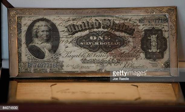 A $1 silver certificate from 1866 featuring first lady Martha Washington is displayed on sale at the Arcade Currency Palace December 17 2008 in Palm...