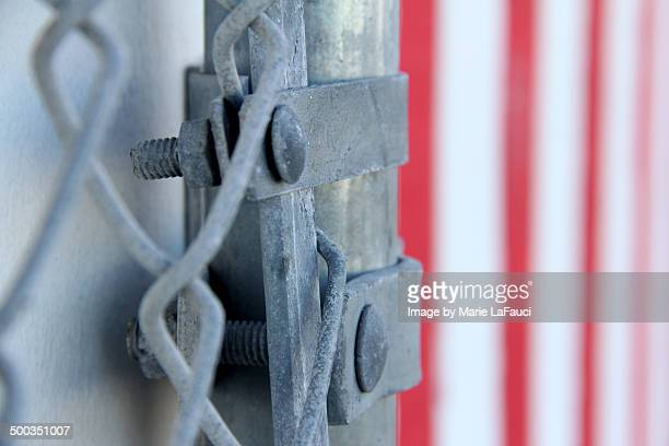 silver chain fence with red striped wall - fauci stock pictures, royalty-free photos & images