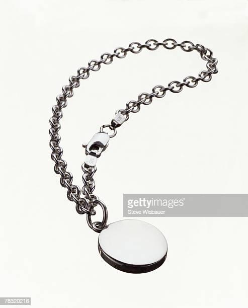 silver charm bracelet - charm bracelet stock pictures, royalty-free photos & images