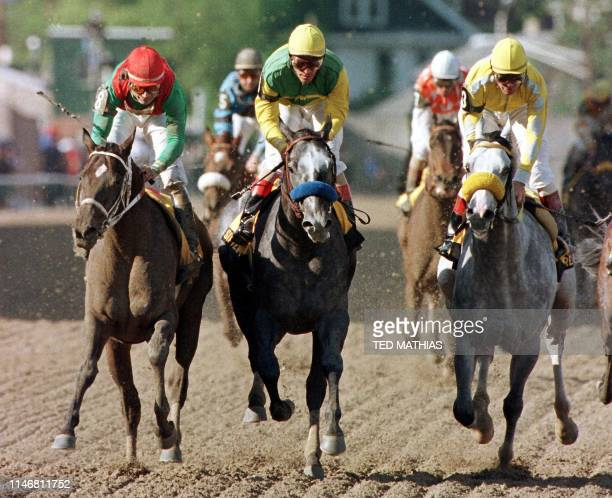 Silver Charm with jockey Gary Stevens aboard crosses the finish line ahead of third place finisher Captain Bodgit and second place finisher Free...