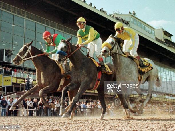 Silver Charm with jockey Gary Stevens aboard crosses the finish line in front of second place finisher Free House and third place finisher Captain...