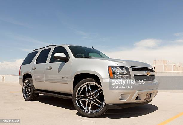 silver chevy tahoe - chevrolet stock pictures, royalty-free photos & images