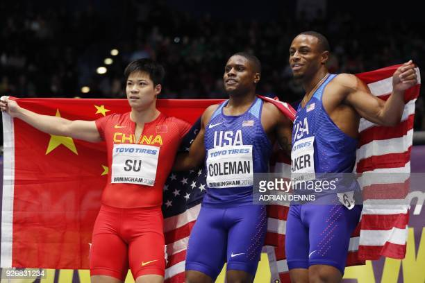 Silver China's Su Bingtian winner US athlete Christian Coleman and bronze US athlete Ronnie Baker pose after the men's 60m final at the 2018 IAAF...
