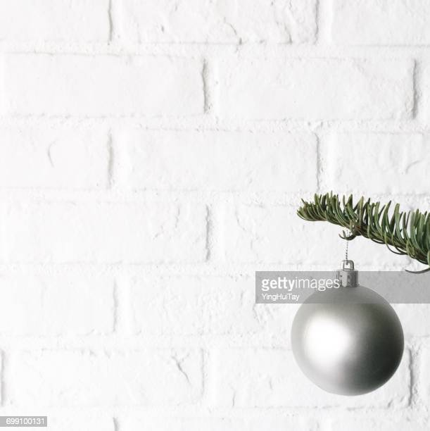 Silver Christmas Bauble hanging on a Christmas tree
