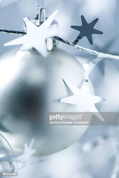 Silver Christmas ornament and star garland, close-up
