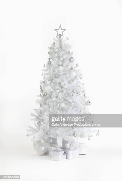 silver christmas tree with gifts - christmas tree stock pictures, royalty-free photos & images
