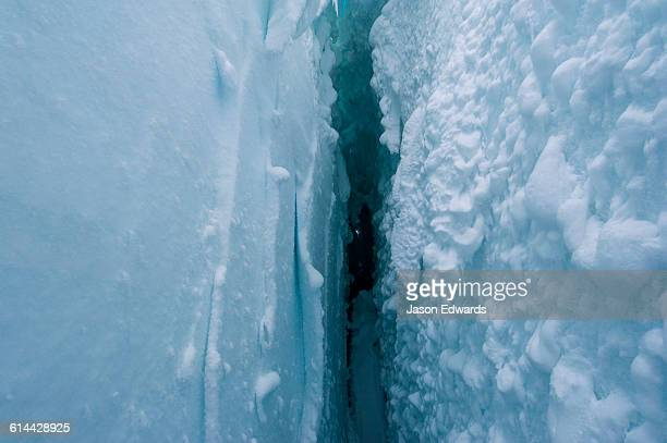 Snow crystals on the cavernous and sheer icy walls of a crevasse on the slopes of Mount Erebus in Antarctica.