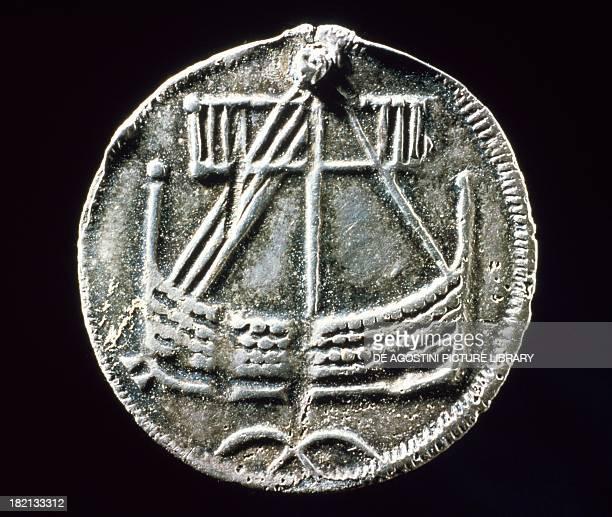 Silver coin bearing the image of a drakkar boat from Birka Lake Marelen Sweden Viking coins Stockholm Historiska Museet