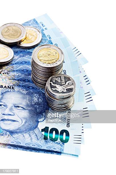 silver coins hold down new south african banknotes featuring mandela - south african currency stock photos and pictures