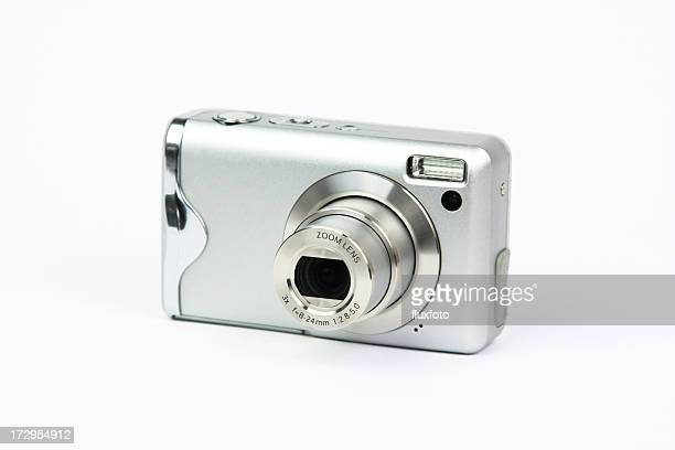 Silver compact, digital zoom camera isolated on white