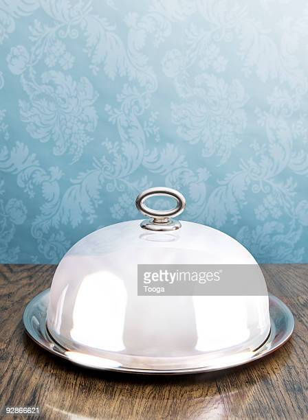 Silver coved serving dish on dining table
