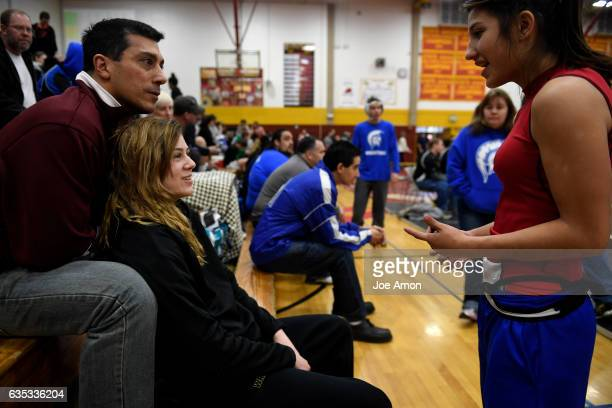 Silver Creek High School wrestler Olivia Ioppolo 111 talking with Jaslynn Gallegos of Brighton 106 before the first Girls State Wrestling Tournament...