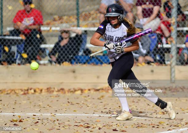 Silver Creek High School's Kayla Harper bunts but is thrown out at first by Windsor in the Class 4A Region 7 Softball Tournament at Garden Acres Park...