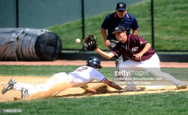 Silver Creek's Marcus Steward slides back to first base as Cheyenne Mountain's Mitch Aguilar defends during the class 4A state semifinals at AllStar...