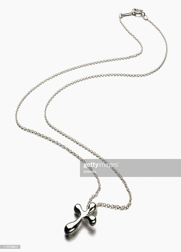 Silver Cross Necklace cut out on white : Stock Photo