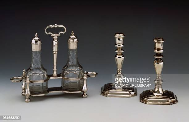 Silver cruet set and a pair of candlesticks 17031707 by Charles Adam London United Kingdom 18th century