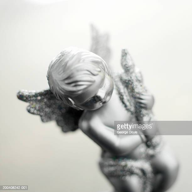 Silver cupid decoration, close-up
