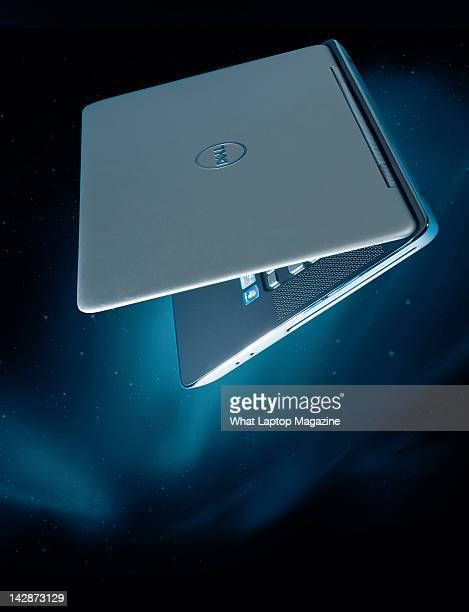 Silver Dell laptop on a space background, July 29, 2011.