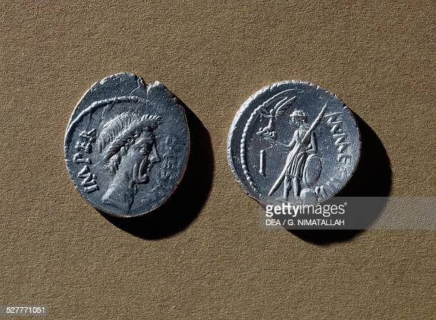 Silver denarius of Emperor Julius Caesar with an effigy of Caesar on the front and an armed soldier and Winged Victory 45 BC Bologna Museo Civico...