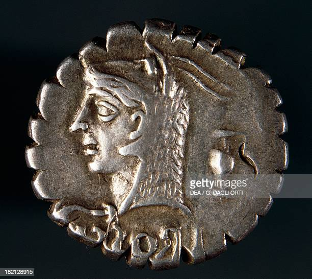 Silver denarius with notches from the Roman Republic bearing the head of Juno Sospita covered with a goat hide recto Roman coins 1st century BC...