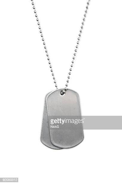 Silver dog tags on a chain on a white background