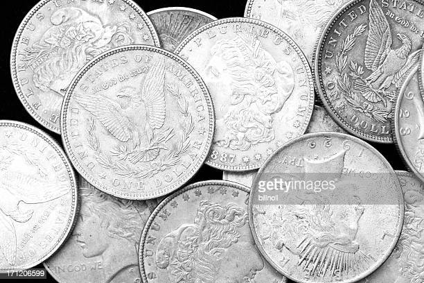 us silver dollars on black background - us coin stock pictures, royalty-free photos & images