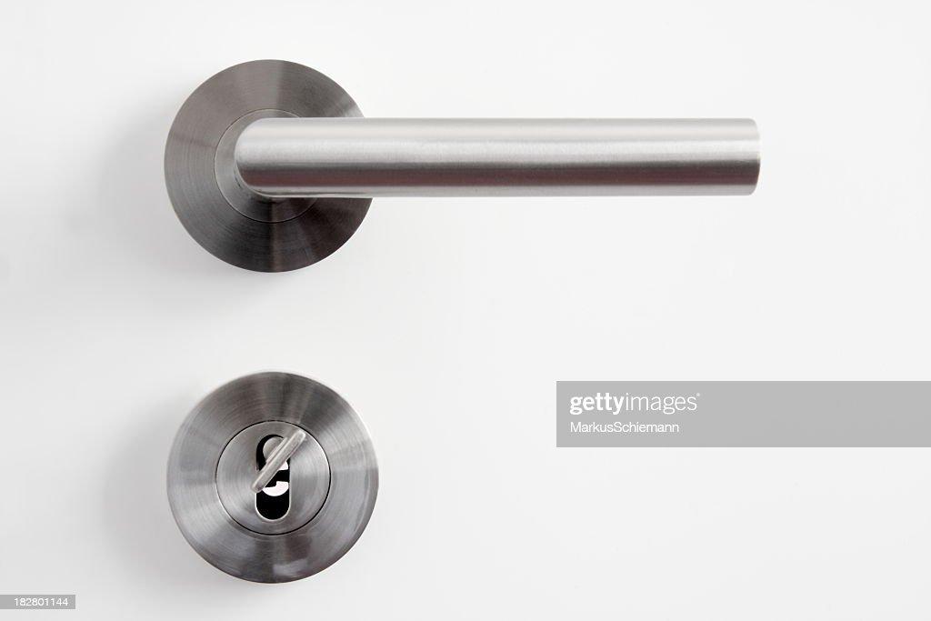... A Silver Door Handle And Lock On A White Door ...