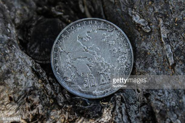 Silver drachma valued 30 drachmas on an olive tree in Artaki on Euboea on July 30 2017