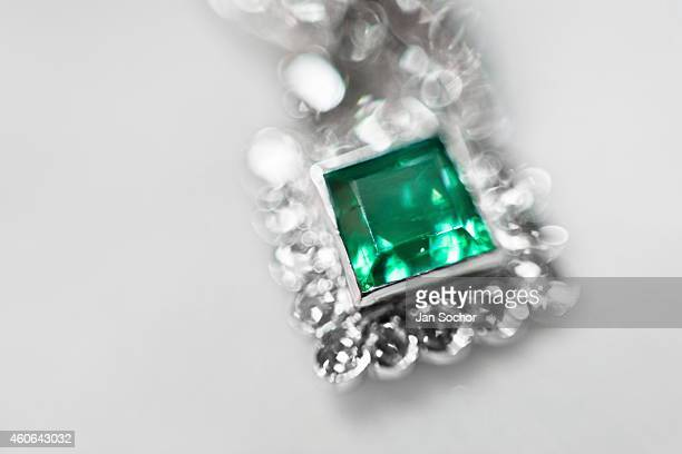 A silver earring with a fine emerald is seen in a jewelry workshop on February 08 2014 in Bogota Colombia Around 60% of the world's emerald...