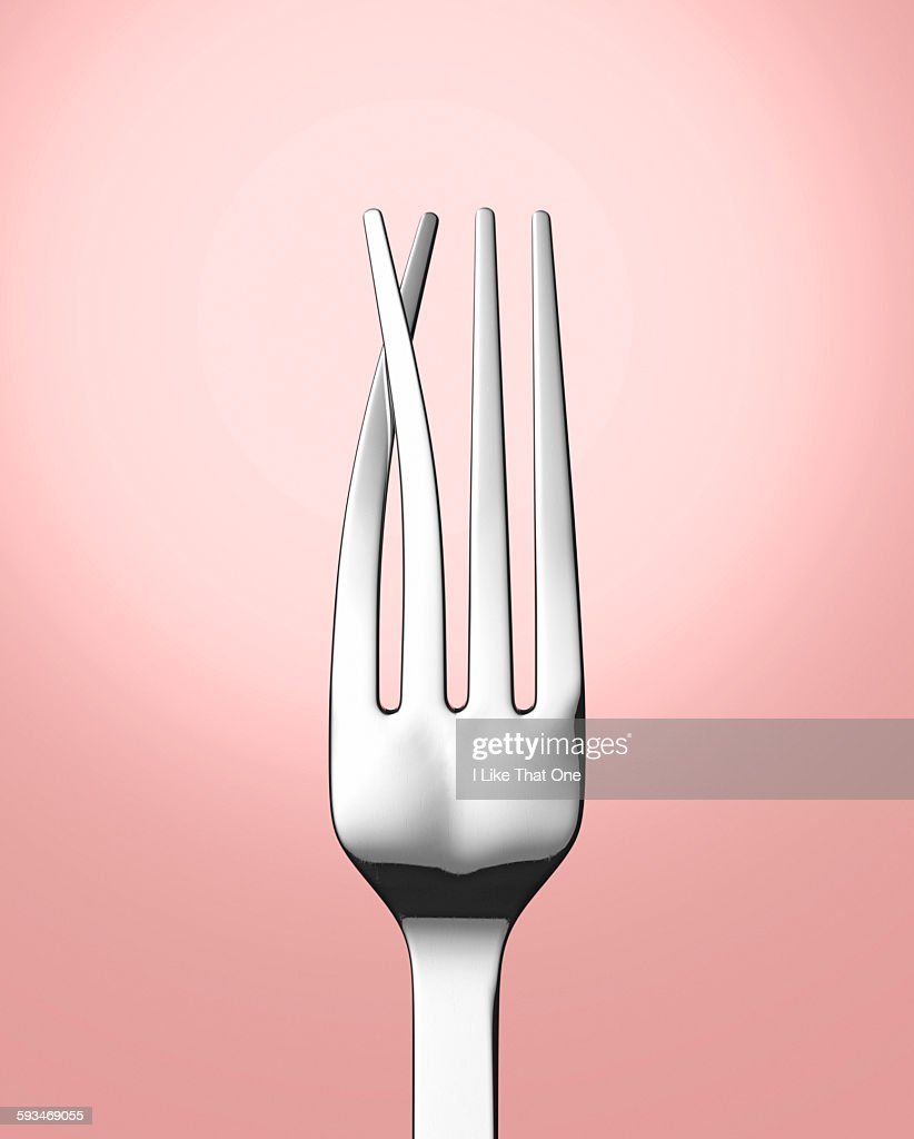 Silver eating fork with prongs crossed : Stock Photo