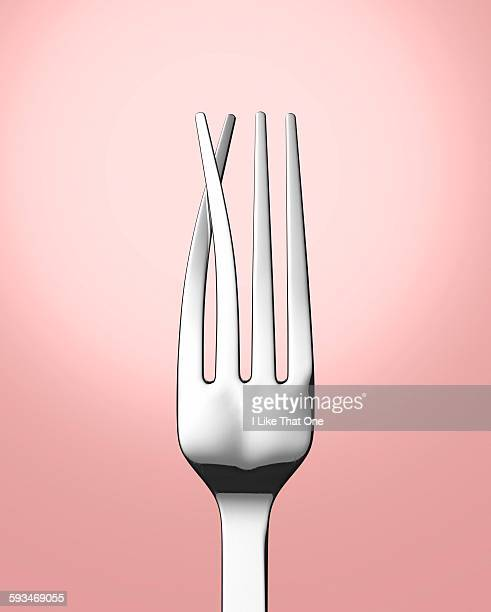 Silver eating fork with prongs crossed