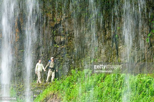 silver falls state park, oregon, usa; hikers behind middle north falls - dan sherwood photography stock pictures, royalty-free photos & images