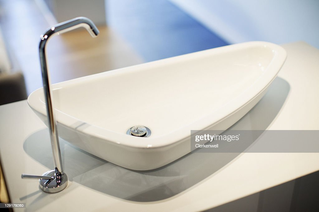 Silver Faucet On Bathroom Sink Stock Photo | Getty Images