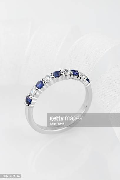 silver female wedding diamonds ring with white and blue colors on white background - ホワイトゴールド ストックフォトと画像