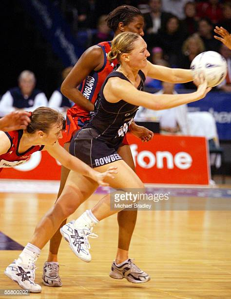 Silver Fern Anna Rowberry passes the ball under pressure from the English defence, during the first netball test of the Fisher and Paykel Series...