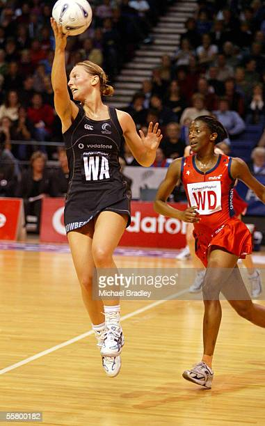Silver Fern Anna Rowberry secures the ball in one hand as Englands Amanda Newton looks on, during the first netball test of the Fisher and Paykel...