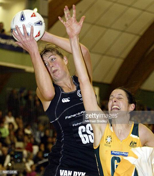 Silver Fern Irene Van Dyk isecures the ballahead of Australian Janine Ilitch during the second Fisher and Paykel test match between the Silver Ferns...