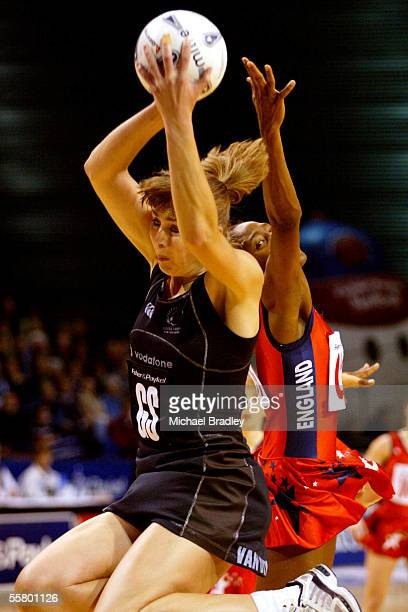Silver Fern Irene Van Dyk secures the ball ahead of Englands Janet Coulbourne during the first netball test of the Fisher and Paykel Series between...