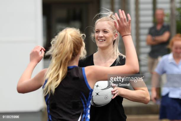 Silver fern Shannon Francois plays a game with Auckland Normal Intermedaite students during the New Zealand Netball Commonwealth Games Team...