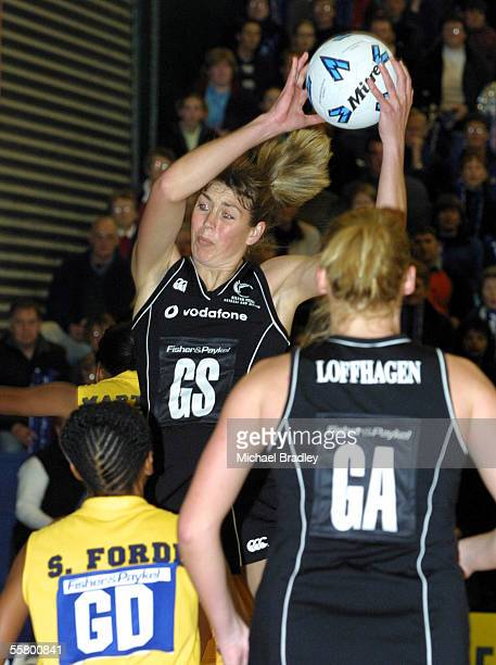 Silver Ferns Irene Van Dyk secures the ball as Barbados goal defence Stacey Forde and Silver Fern Donna Loffhagen look on during the first of three...
