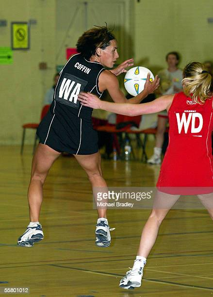 Silver Ferns JennyMay Coffin secures the ball as Welsh player Beverly Lovatt looks onduring the Netball match between the New Zealand Silver Ferns...