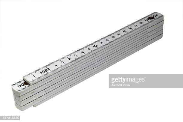 A silver folding ruler on a white background