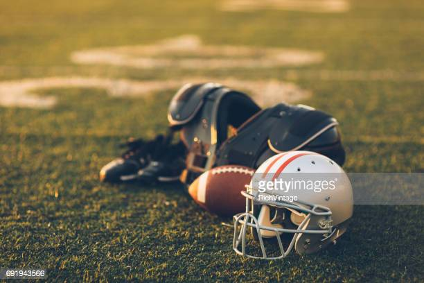 silver football helmet on field - sports uniform stock pictures, royalty-free photos & images