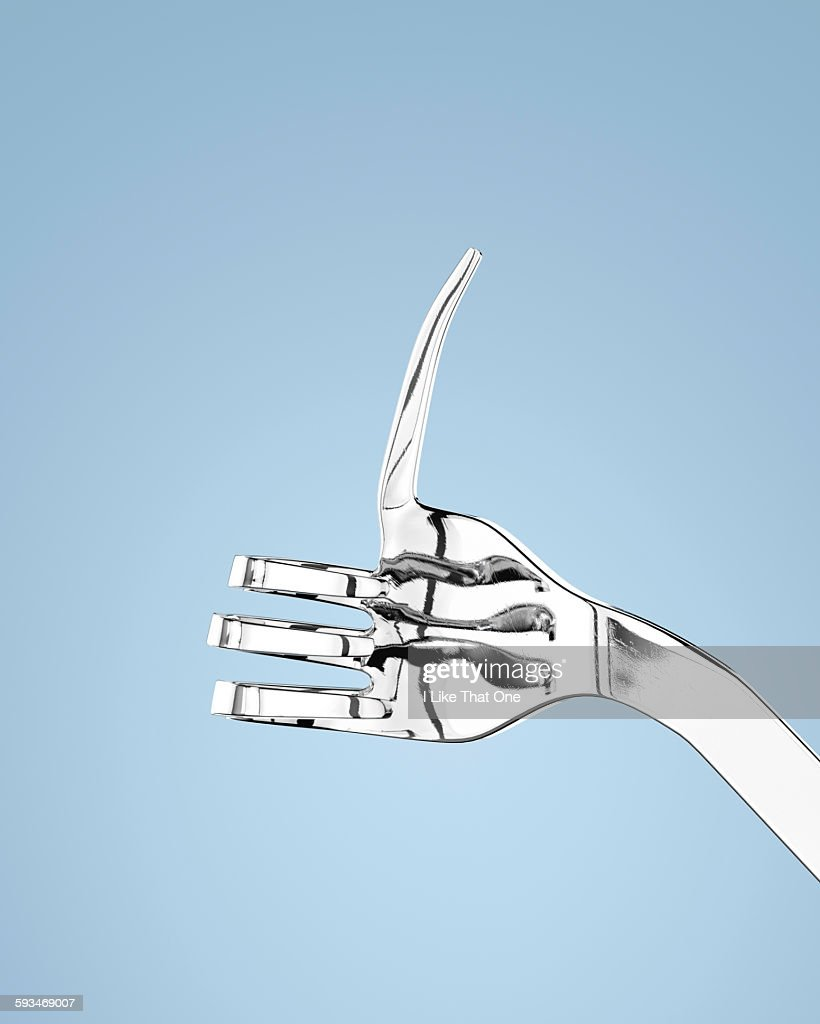 "Silver fork with bent prongs to mimic ""Thumbs Up"" : Stock Photo"