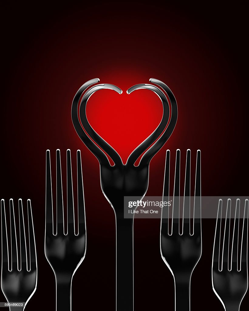 Silver forks in the shape of a heart : Stock Photo