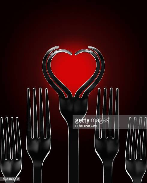 silver forks in the shape of a heart - atomic imagery stock pictures, royalty-free photos & images