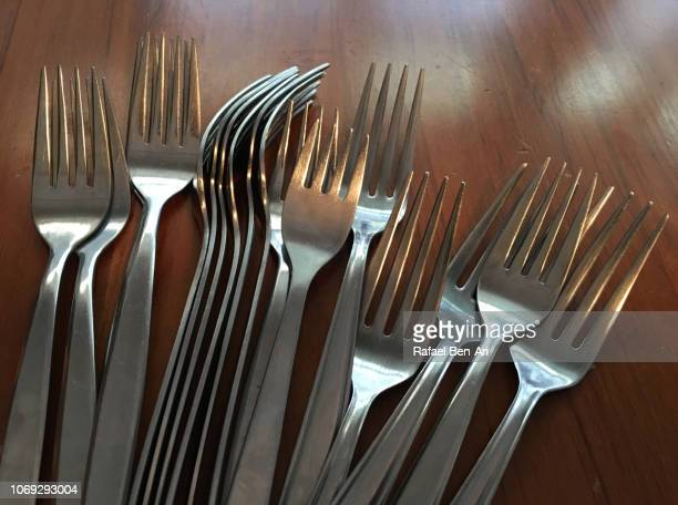 Silver Forks on a Wooden Table